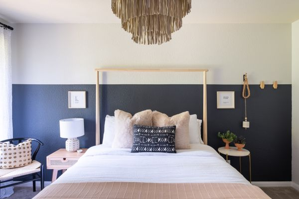 Guest bedroom with navy and pink accents.