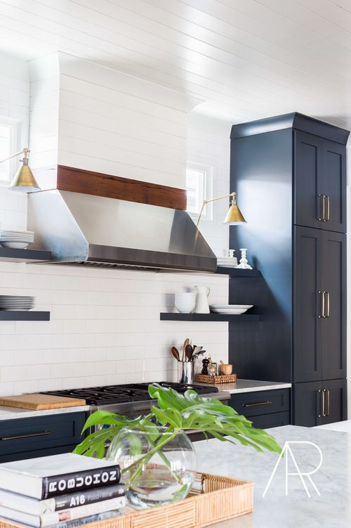 Classic kitchen with navy cabinets and open shelves