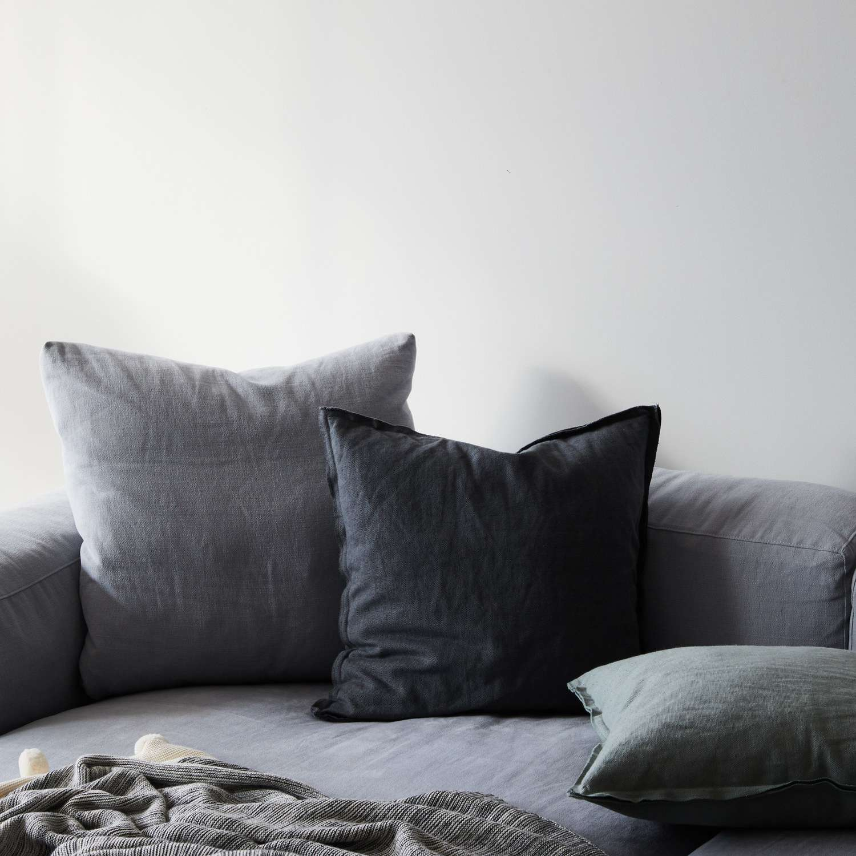 Cozy sofa setup in slate blue tones