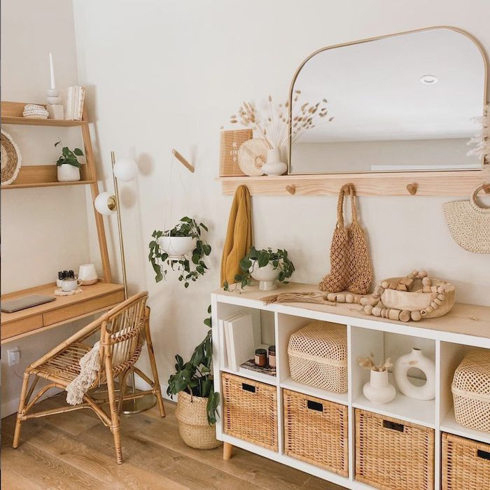 warm tone entryway that includes dresser with wicker baskets, mirror,
