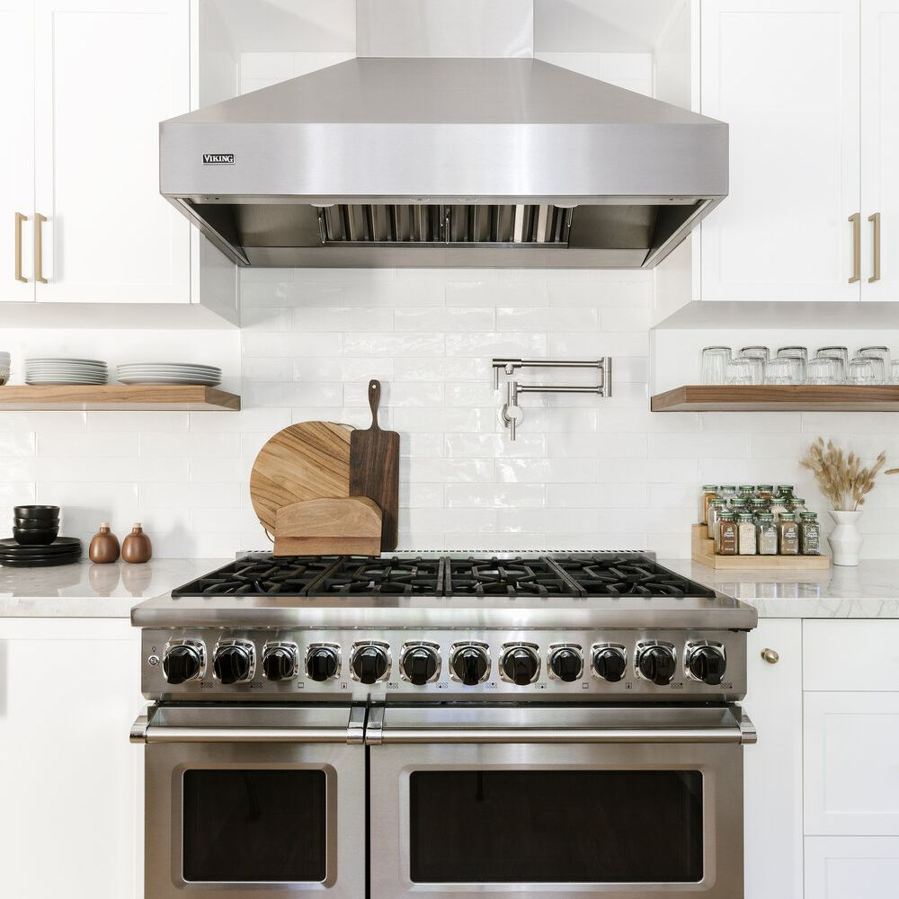 A minimalist kitchen with a stainless steel stovetop