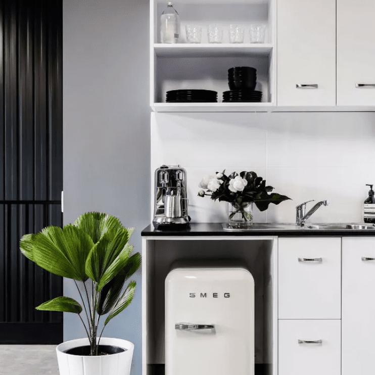 Minimalist kitchen with Smeg fridge, open shelves