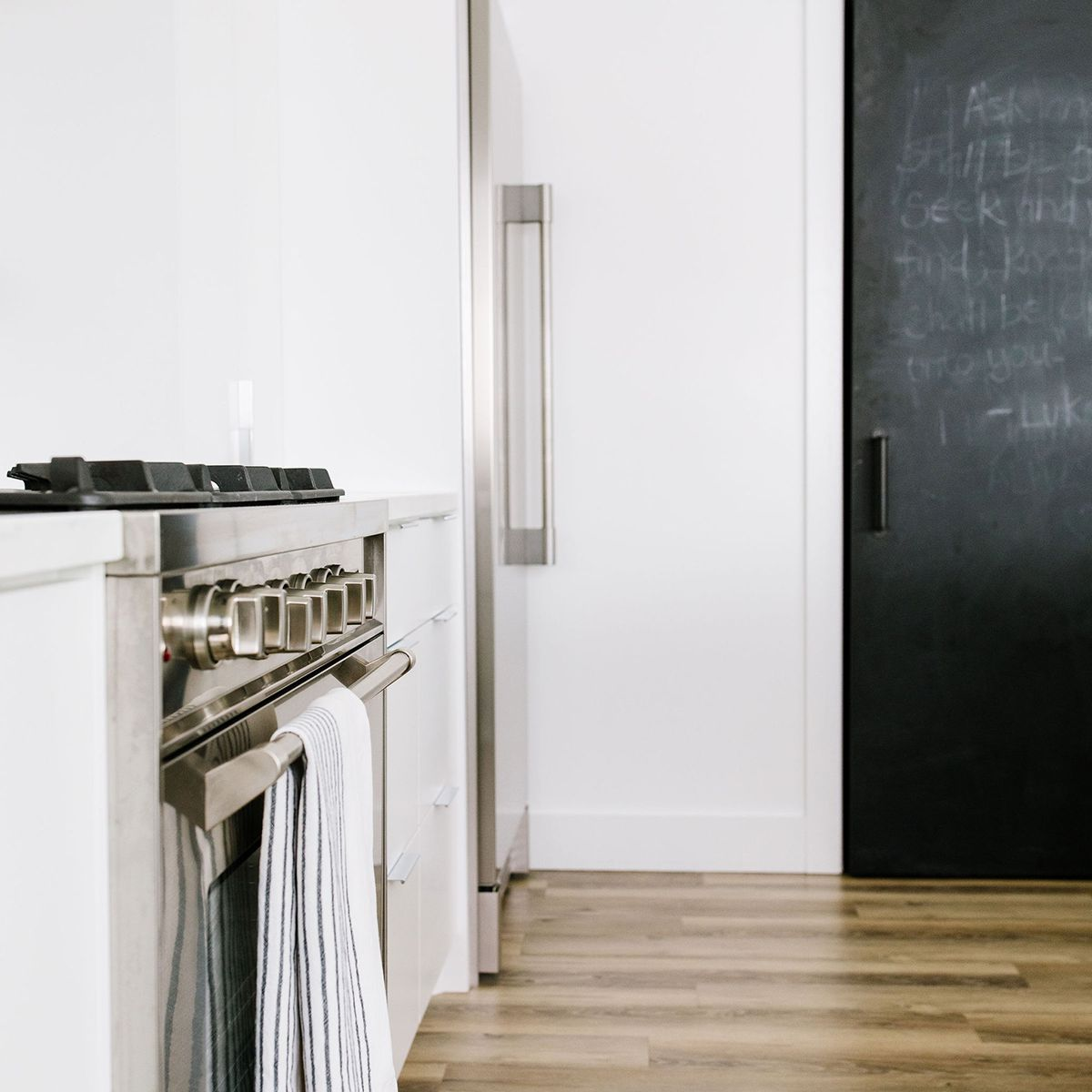 White kitchen—black door