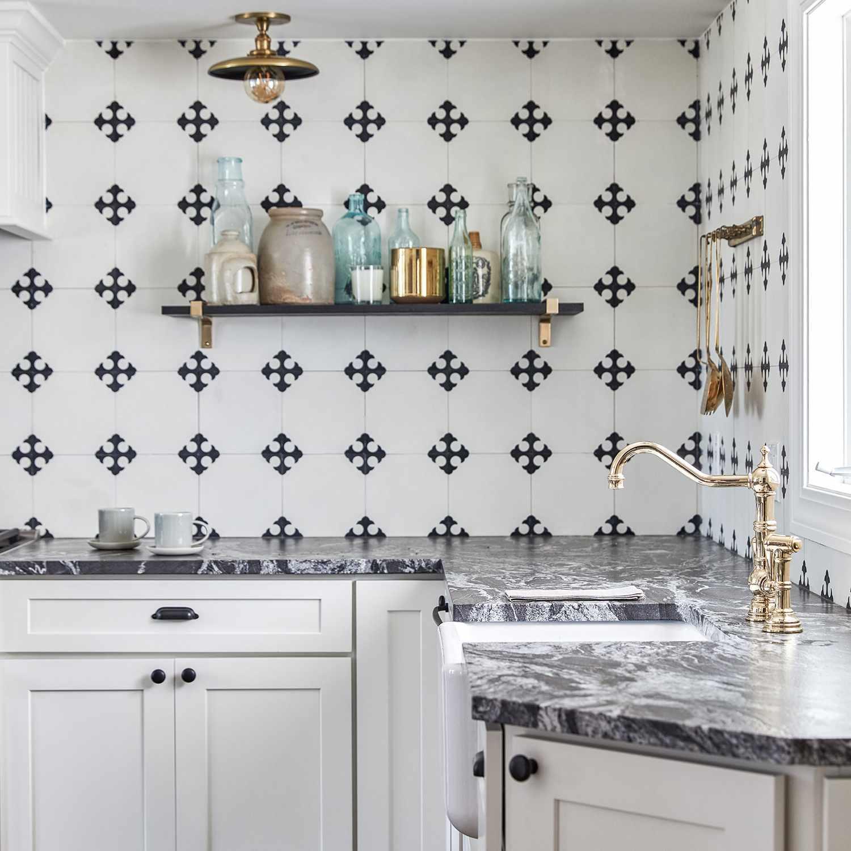 A kitchen with a boldly tiled backsplash
