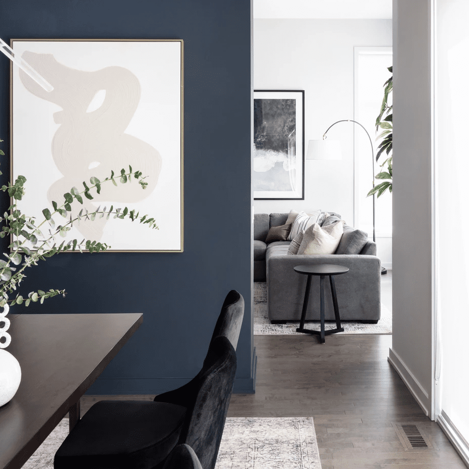 A dining room with an indigo wall