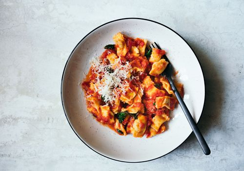 bowl of pasta with red sauce