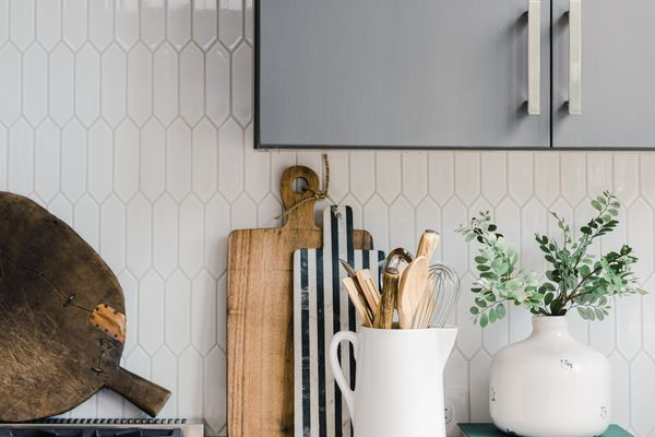Arranged Ceramics And Cutting Boards In Kitchen