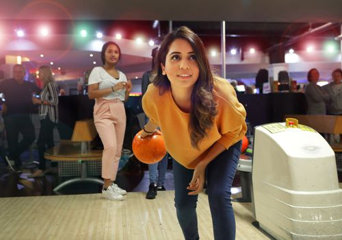 Two people bowling.