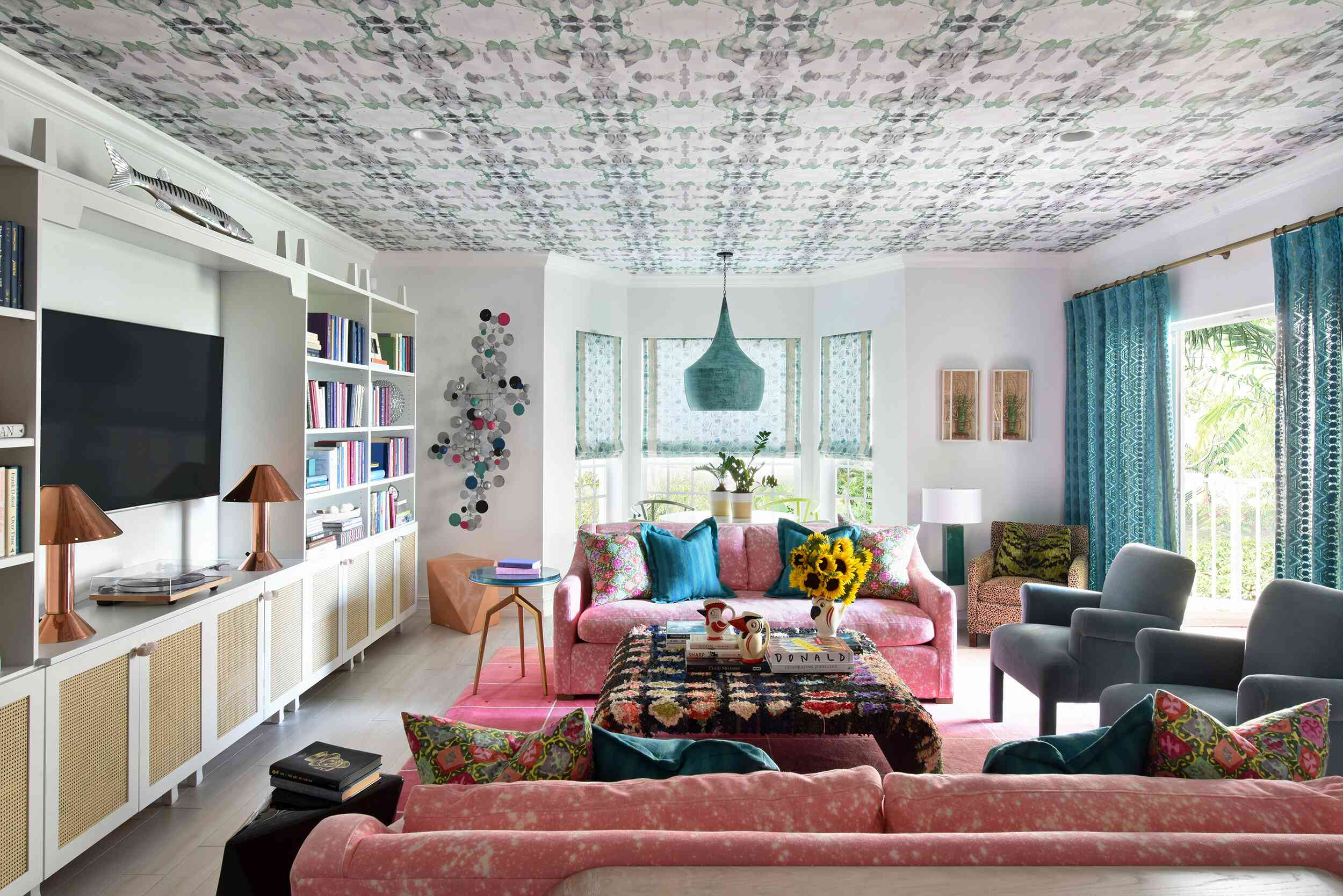 Maximal living room with wallpapered ceiling.
