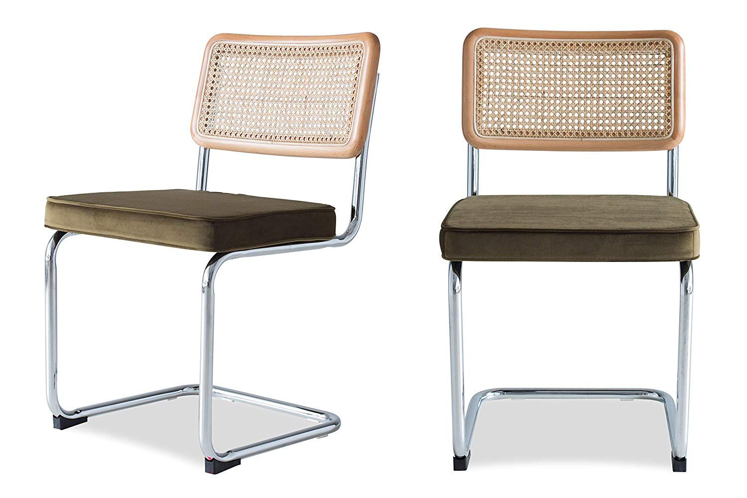 Two midcentury style cantilevered dining chairs with rattan backs and velvet seats.