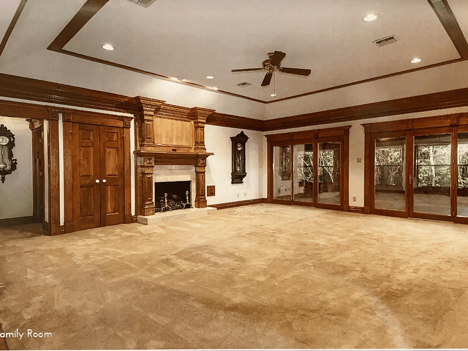 Before shot of large, dark living room.