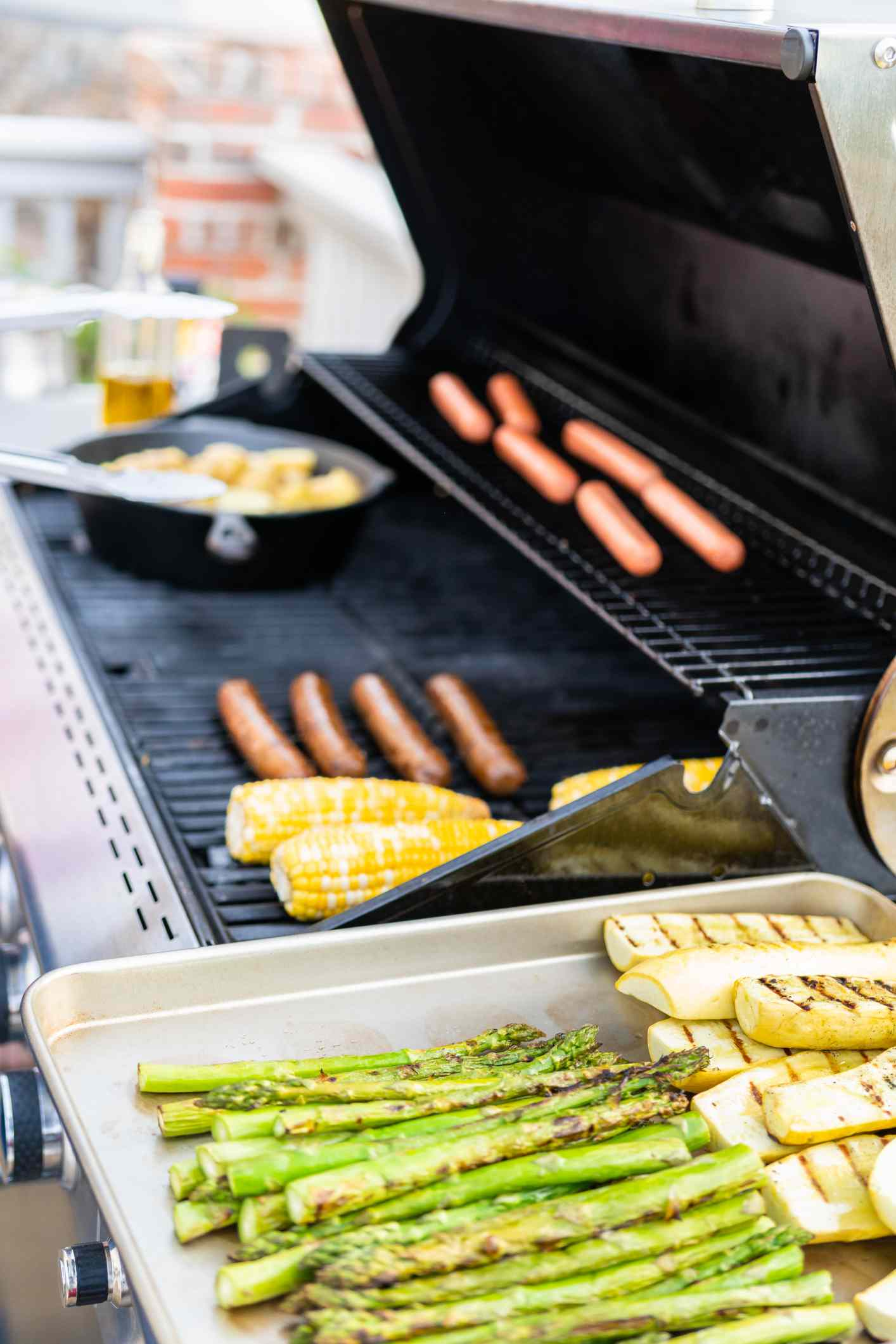 how to clean a grill - propane grill cookout with meat and vegetables