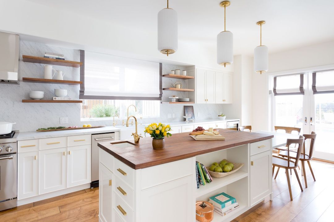 Kitchen with gold hardware.