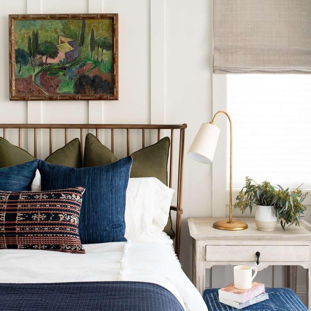A bedroom with several indigo pieces