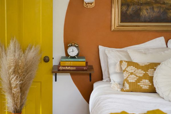 Bedroom with yellow and orange accents and painted sun