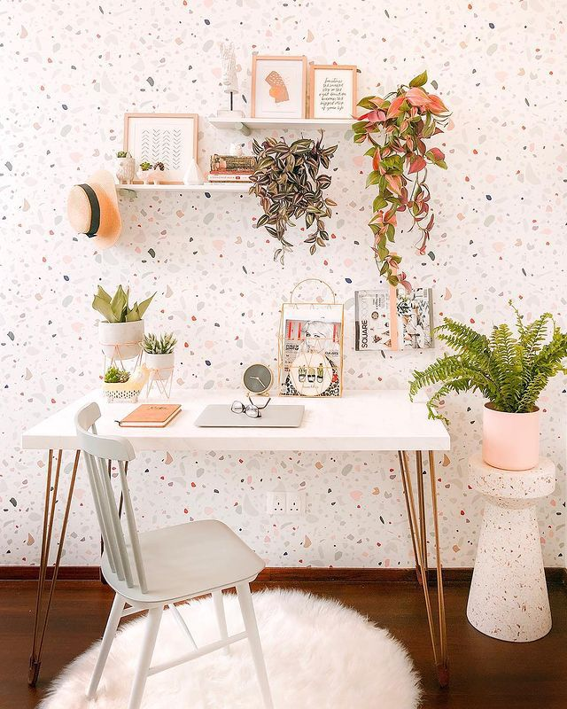 Wandering jew on floating shelves in a modern, colorful home office