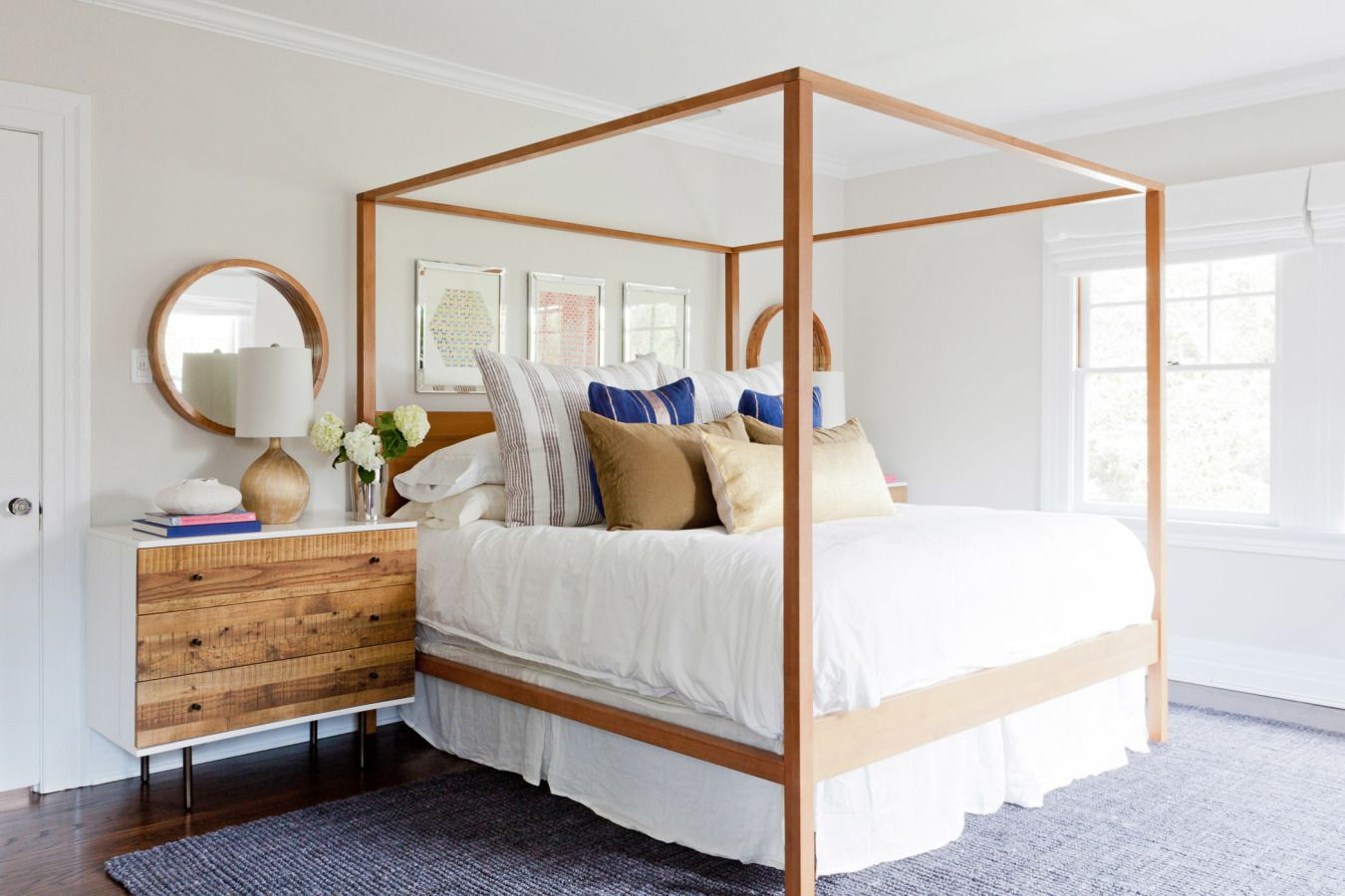 A beachy bedroom with a light brown canopy bed