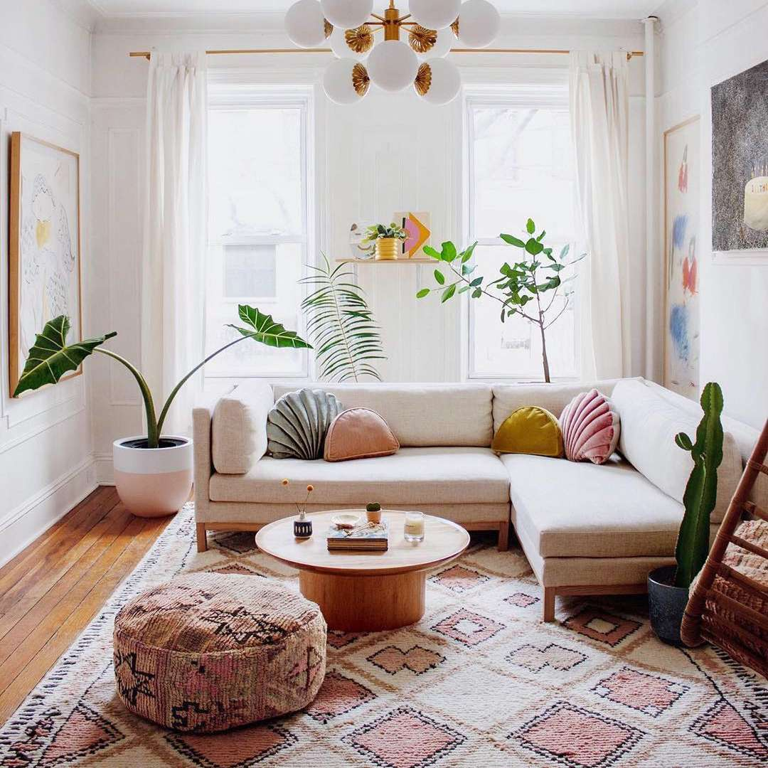 Boho eclectic living room with fun shell pillows.