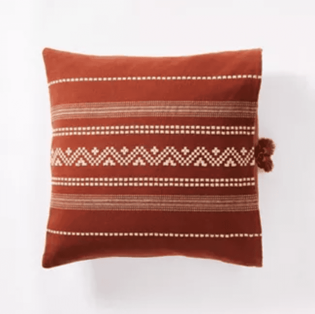 Square textured throw pillow in rust color