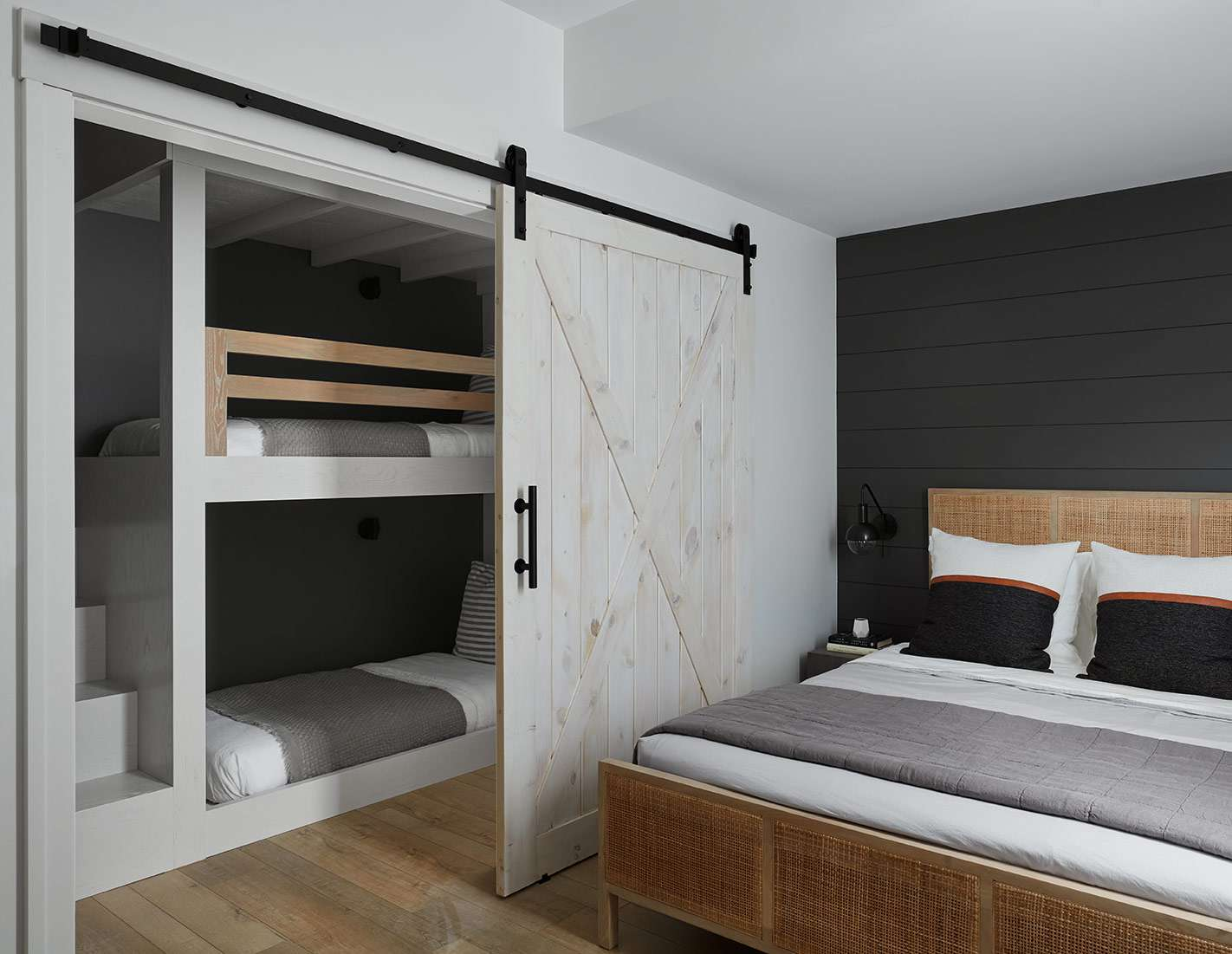 Gray and white bunk beds in room