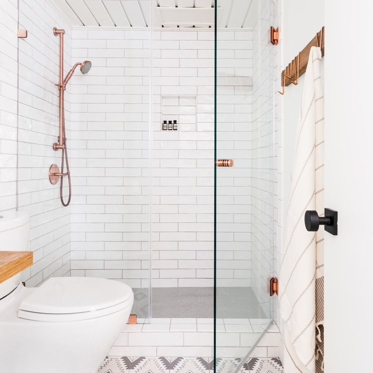 White bathroom with patterned tile flood