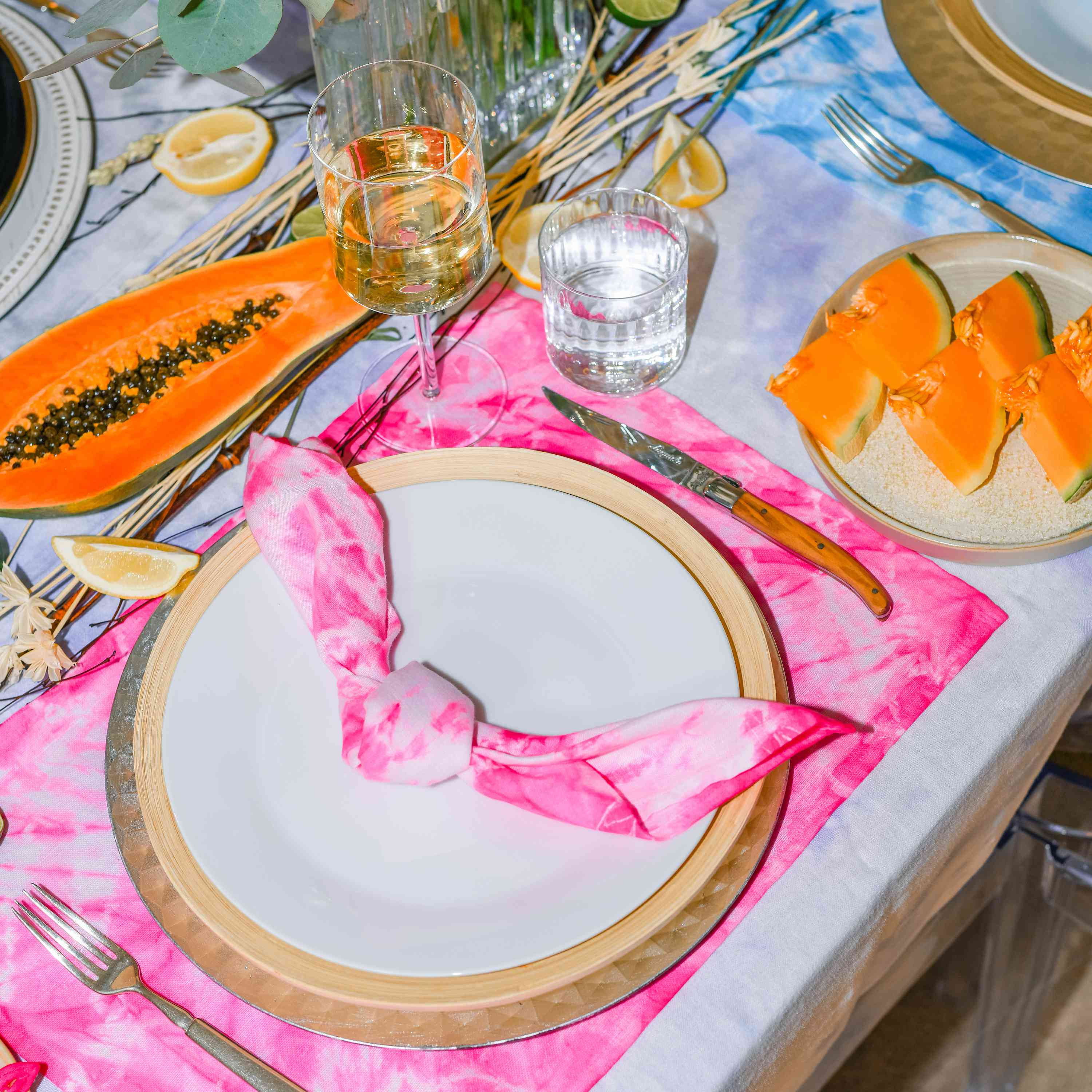 Tablescape with tie dye linens.