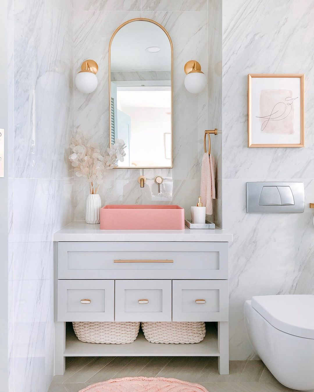 gray bathroom with gold mirror
