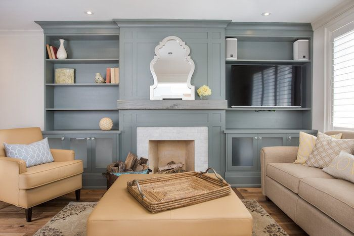 matte gray and tan living room with ornate silver mirror and white brick fireplace