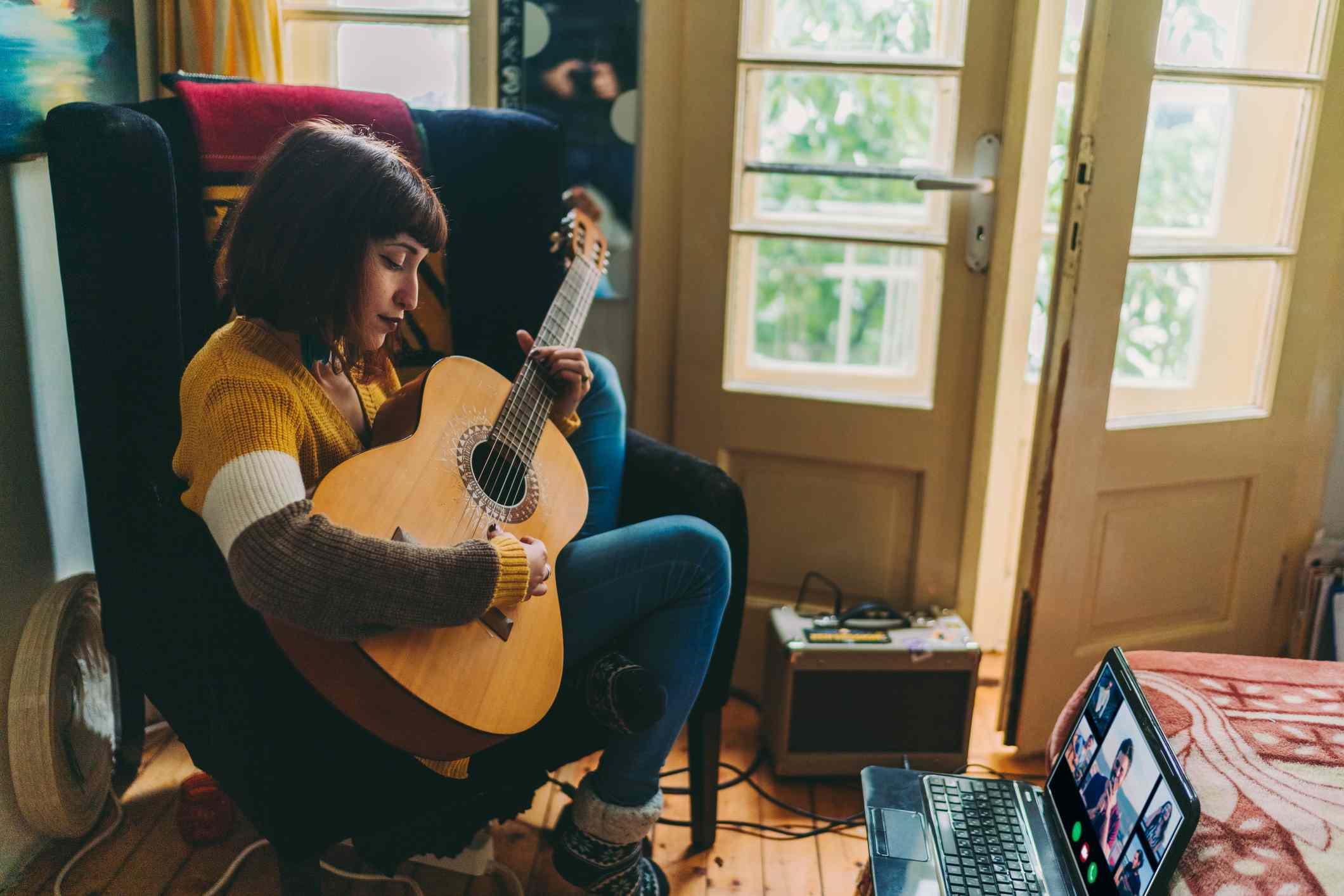 Woman plays guitar