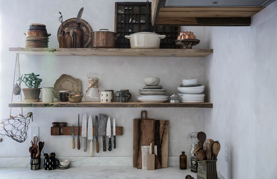 Kitchen shelves lined with rustic products