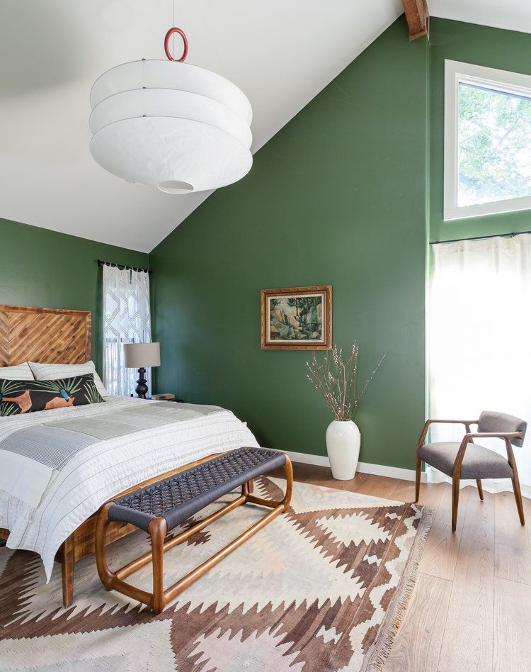 Green angular bedroom space.
