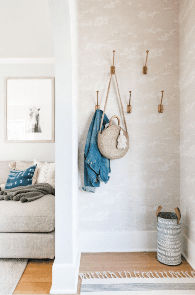 Entryway space with coat hooks.