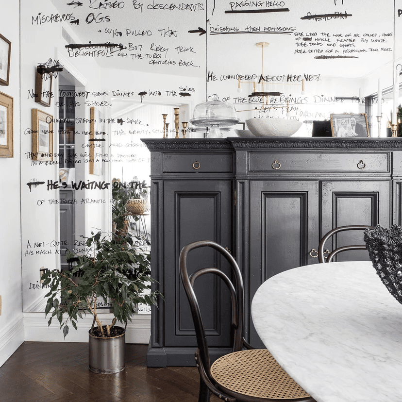 A room with decorated mirrors and revamped vintage furniture