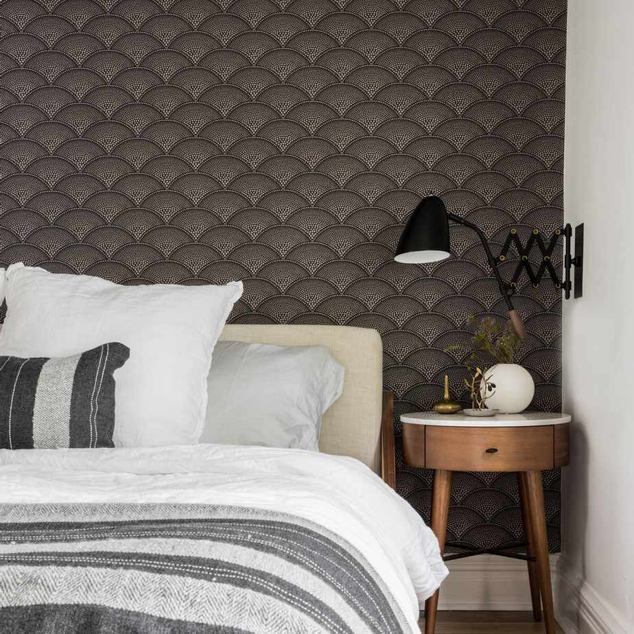 Modern bedroom with dark gray and gold accent wallpaper