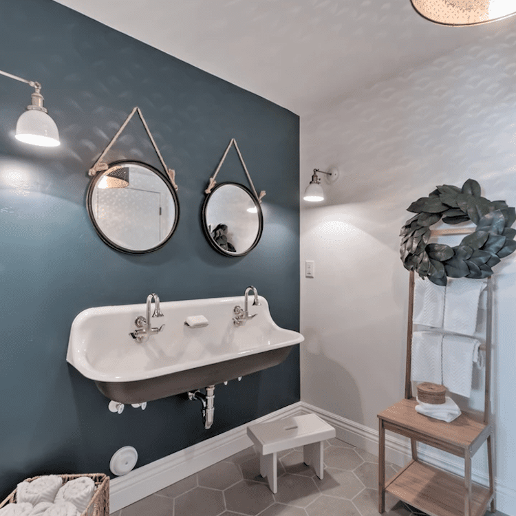 A powder room with a wide wall-mount sink