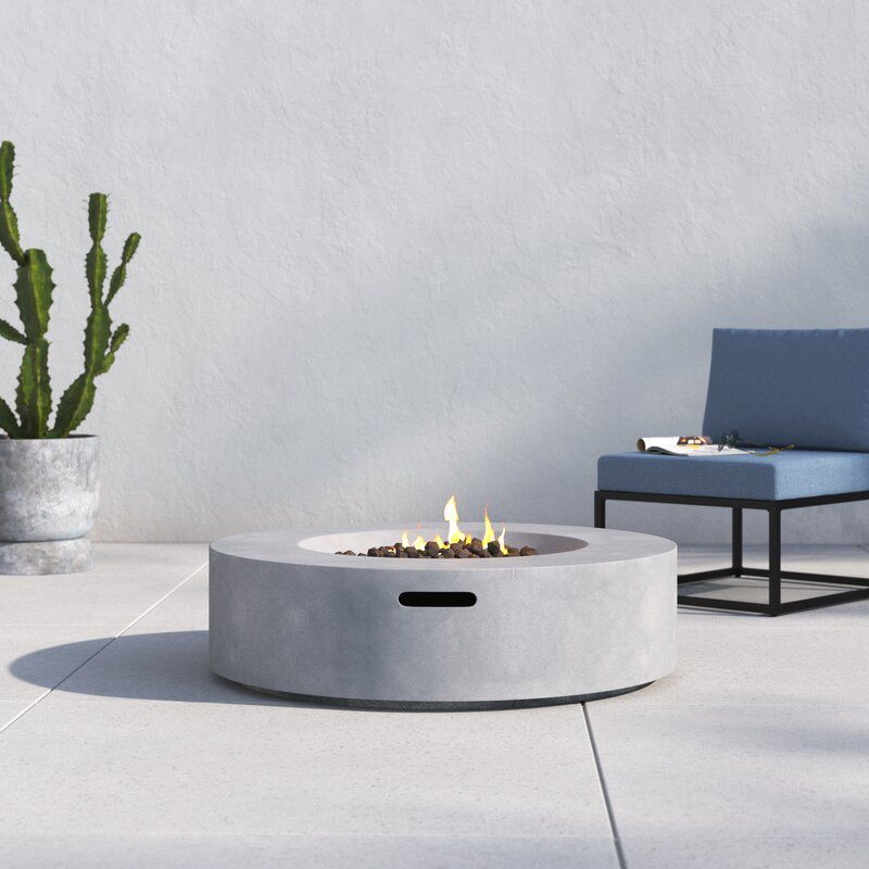 A concrete fire pit, currently for sale at AllModern