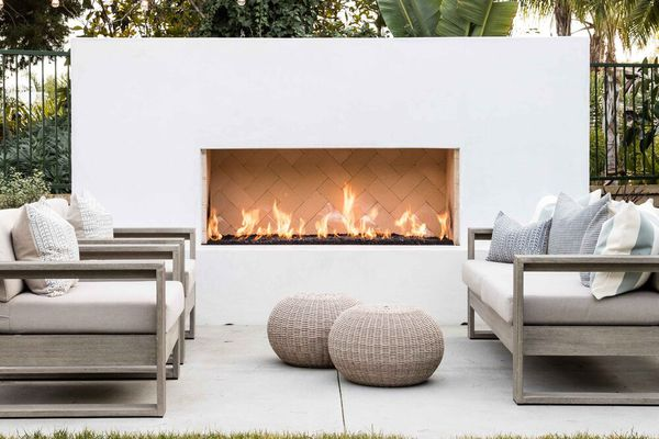 An outdoor space with a pool and a fireplace