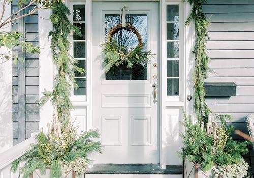 front door with wreath and garland