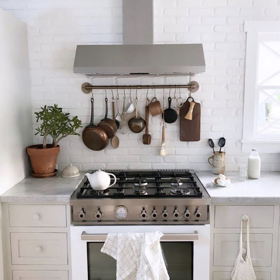 kitchen with white painted brick