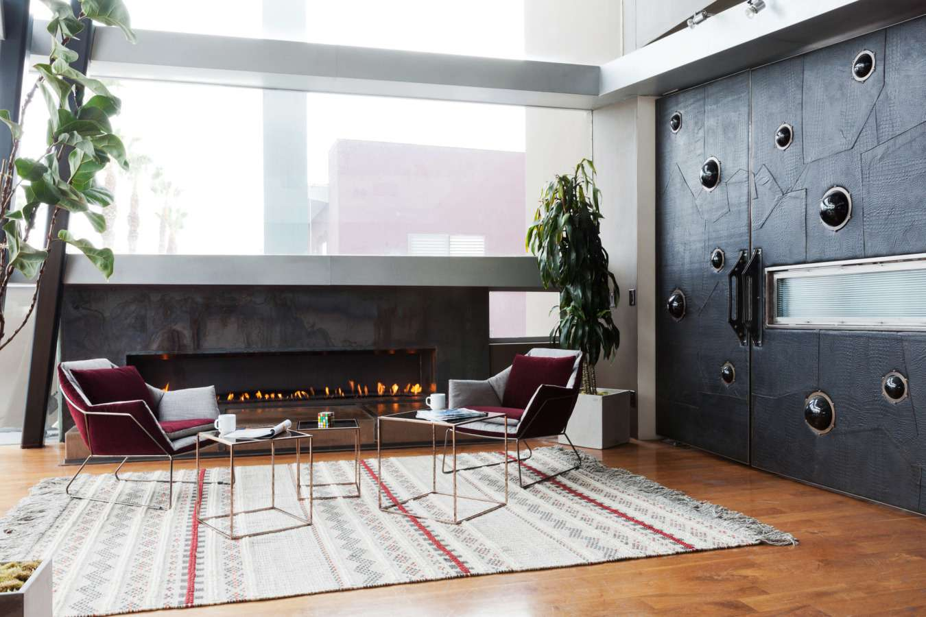 Industrial living room with plum chairs.