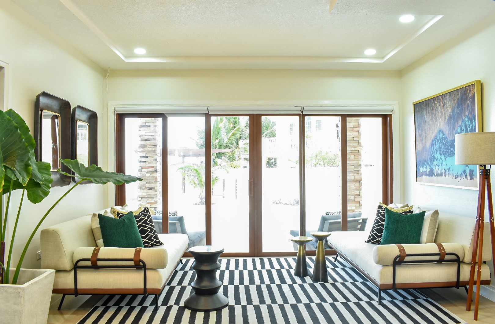 Vibrant living room with black and white rug.