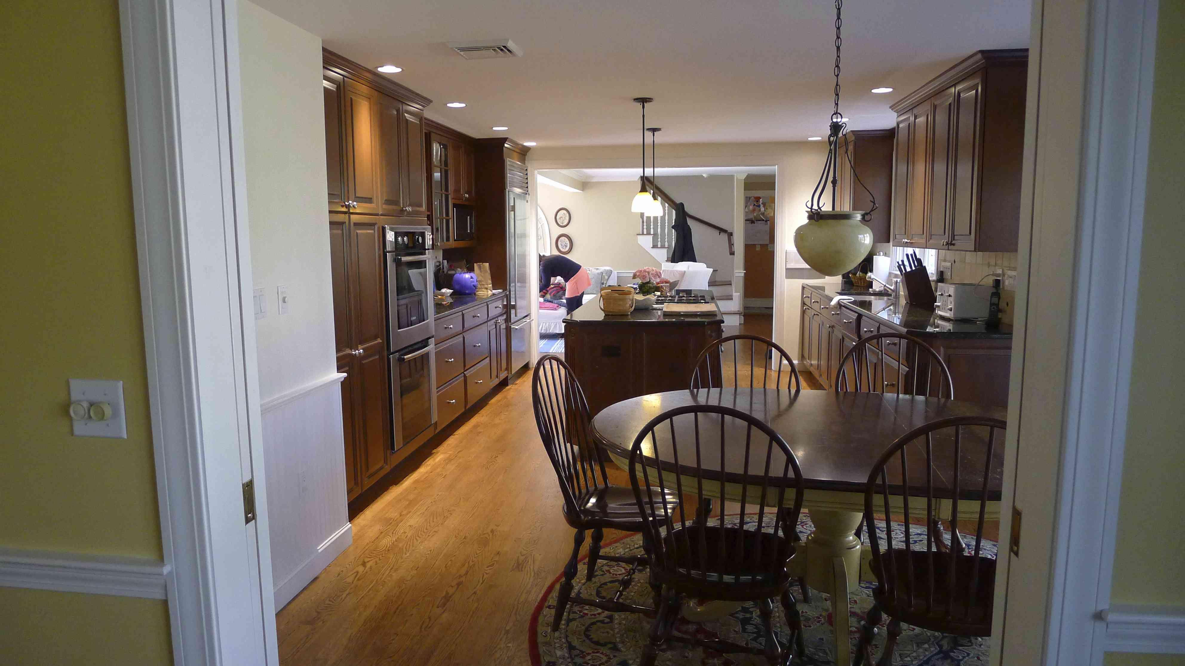 Dark kitchen with cherry wood cabinets.