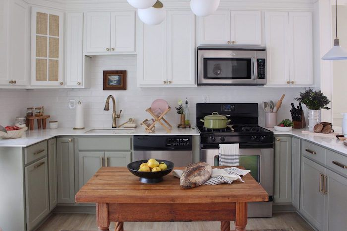 white and pale green kitchen with wooden island and modern farmhouse vibes