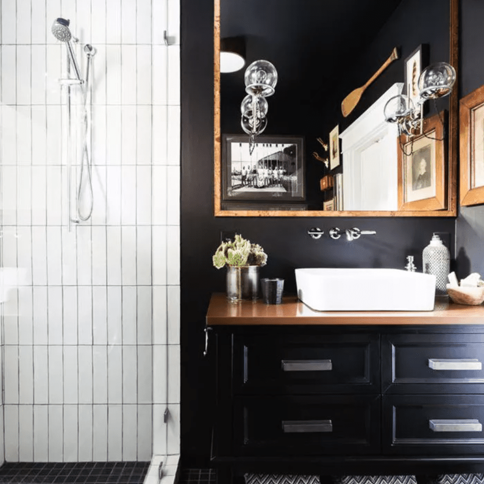 Black and white bathroom with white vertical shower tiles