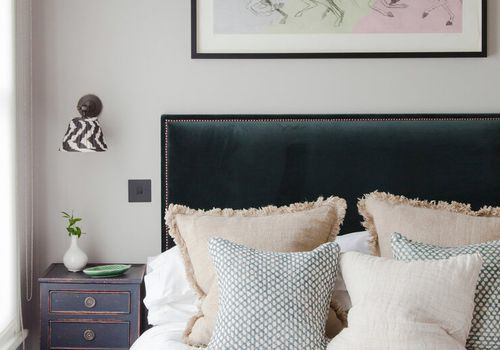 Bed with chalk painted nightstand.
