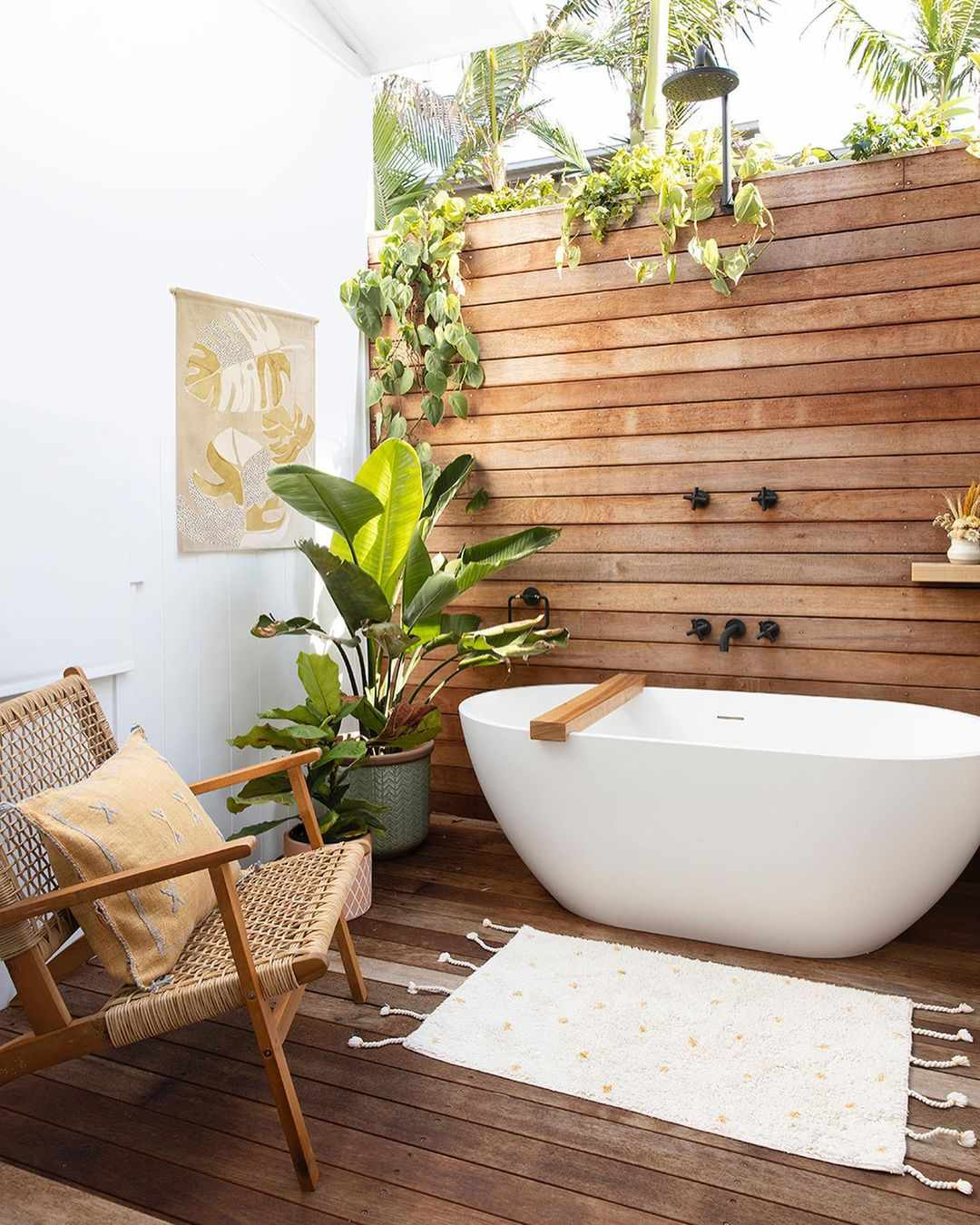 Standing tub with wood behind it