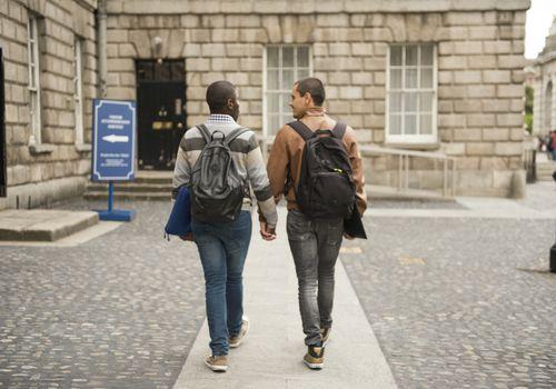 Couple walks hand in hand.