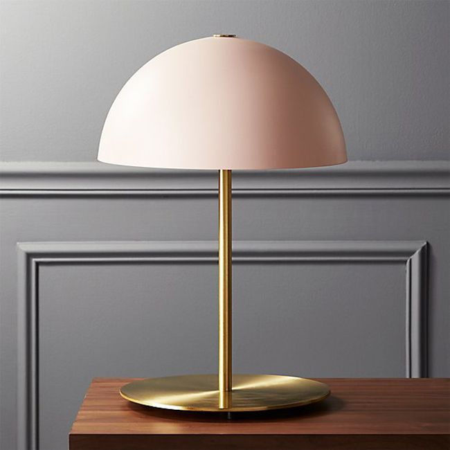 Pink table lamp with gold base.