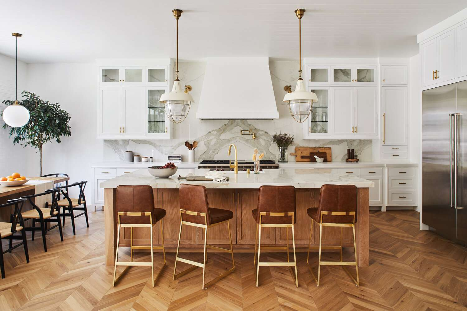 An open-concept kitchen adjacent to a dining room
