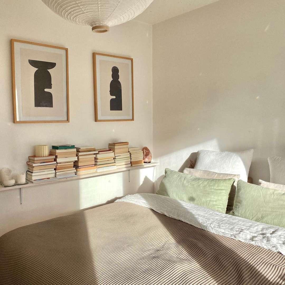 Bedroom with tan bedspread